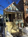 Winter bungalow this is a picture of a surrounded by snow in the wrigleyville neighborhood of chicago illinois this home was built Royalty Free Stock Photo