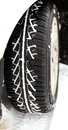 Winter car tyre in the snow Royalty Free Stock Photo