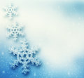 Winter christmas background with big snowflakes snow storm frost glittering lights Royalty Free Stock Images