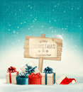 Winter christmas with a sign gift boxes and a santa hat background vector Stock Photography