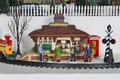 Winter christmas village train station scene people wait for a locomotive to arrive in a seasonal holiday Royalty Free Stock Photos
