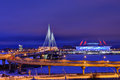 Winter cityscape with stadium, cable-stayed bridge and highway a Royalty Free Stock Photo