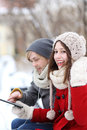 Winter couple with digital tablet Stock Photography