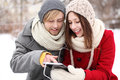 Winter couple with digital tablet Stock Photos