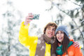Winter couple taking picture of themselves having fun on day Stock Photography