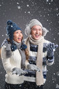 Winter couple vertical image of a funny having fun with snow Royalty Free Stock Image