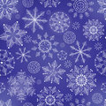 Winter dark blue background with snowflakes. Royalty Free Stock Photo