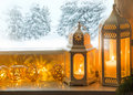 Winter decoration with lanterns on windowsill