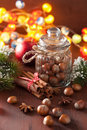 Winter decoration spices cinnamon christmas tree nuts lights Royalty Free Stock Photo