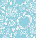 Winter decorative seamless pattern. Cute background with hearts and flowers. Fabric ornate texture for wallpapers, prints, crafts, Royalty Free Stock Photo