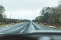 Winter drive on rural road in western Oregon. Rainy winter day s Royalty Free Stock Photo