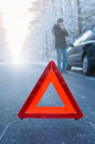 Winter driving car breakdown on a country road in woman standing beside her and waiting for help Stock Photos