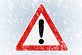 Winter driving winter background with warning si snow on an ice covered windshield sign Royalty Free Stock Image
