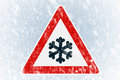 Winter driving winter background with warning sign snow on an ice covered windshield copy space and Stock Images