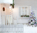 Winter exterior of a country house with Christmas decorations in the American style. Royalty Free Stock Photo