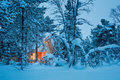 Winter fairy night - wooden cottage in snowy forest Royalty Free Stock Photo