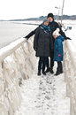 Winter family walk at Darlowo beach Royalty Free Stock Photo