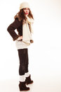 Winter fashion full length of curly girl woman in warm clothing young isolated studio shot Royalty Free Stock Photos