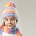 Winter fashion portrait of girl in knitted hat and scarf on a light background Royalty Free Stock Photos