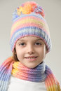 Winter fashion portrait of girl in knitted hat and scarf on a light background Stock Images