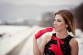 Winter fashion portrait of interesting woman in snow Royalty Free Stock Image