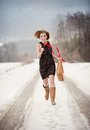 Winter fashion portrait of interesting woman in snow Stock Photo