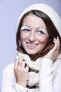 Winter fashion woman warm clothing creative makeup beautiful in stylish make up false long white eye lashes blue background Stock Images