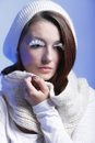 Winter fashion woman warm clothing creative makeup beautiful in stylish make up false long white eye lashes blue background Royalty Free Stock Photos