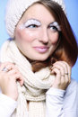 Winter fashion woman warm clothing creative makeup beautiful in stylish make up false long white eye lashes blue background Royalty Free Stock Photography