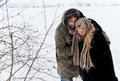 Winter field strugle couple Royalty Free Stock Images