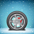 Winter flat tire on snow background Royalty Free Stock Photo