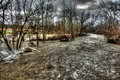 Winter flood raging waters in wolf creek near the town of balville ohio large broken ice chunks can be seen in the left of the Royalty Free Stock Images