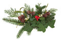 Winter floral display christmas arrangement with holly ivy mistletoe pine cones and greenery over white background Stock Images