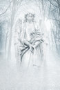 Winter forest angel angelic female figure materialising in an atmospheric misty rendered in cool blue tones Stock Image