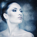 Winter freshness abstract female portrait with falling snow as background Royalty Free Stock Photo