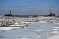 Winter frozen docks old ship an and icy and empty at port credit mississauga ontario canada on the north shore of lake ontario Stock Images