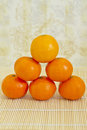 Winter fruits: piled clementines Stock Photography