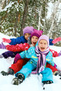 Winter fun, happy children sledding at winter time Royalty Free Stock Photo