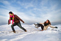 Winter fun man pulling girl on a sled at snow concept Royalty Free Stock Photography