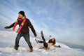 Winter fun man pulling girl on a sled at snow concept Stock Photography