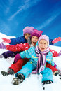 Winter fun, snow,  children sledding at winter time Royalty Free Stock Photo
