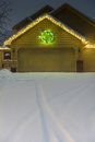 Winter Garage with Holiday Lights and Tracks Vertical Royalty Free Stock Photo