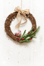 Winter garland hanging from door with falling snow Stock Images