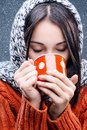 Winter girl attractive young lady drinking from cup Royalty Free Stock Photos