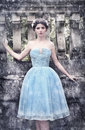 Winter girl in blue silk gown Royalty Free Stock Photo