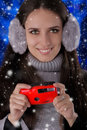 Winter girl with camera beautiful holding a photo snow falling around her Royalty Free Stock Image