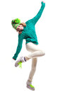 Winter girl cute wearing warm woolen knitted sweater yellow green bright hat with pompon light yellow pants boots with green laces Stock Photos