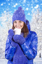 Winter girl drinking warm beverage. Stock Photos