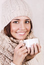 Winter girl drinking warm beverage. Royalty Free Stock Photo
