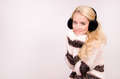 Winter girl with earmuffs beautiful fashionable in brown and gold clothes in and wears Royalty Free Stock Photos